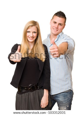 Studio portrait of an attractive young student couple isolated on white background.
