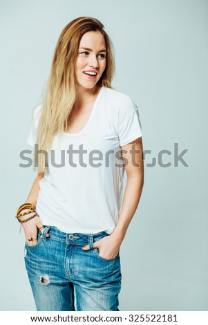 Studio portrait of an attractive young woman in jeans