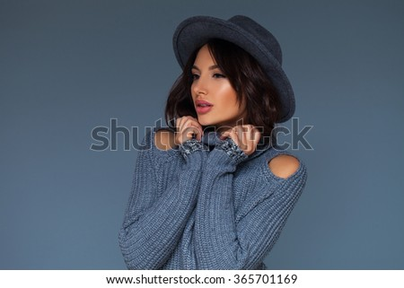 Studio portrait of an emotional woman over neutral grey background