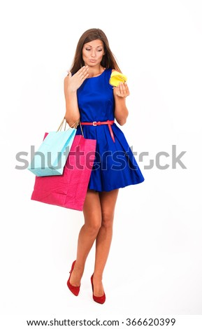 Studio portrait of an uneconomical girl with the empty purse - stock photo