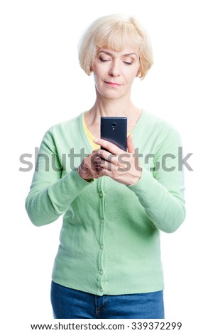 Studio portrait of attractive blond middle age woman using smartphone. Isolated on white. - stock photo