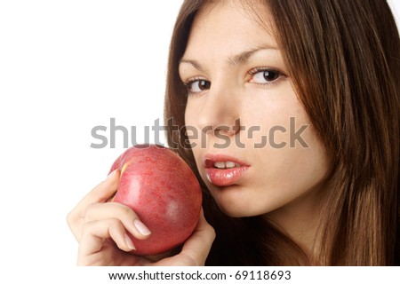 studio portrait of attractive young woman with red apple against white background - stock photo