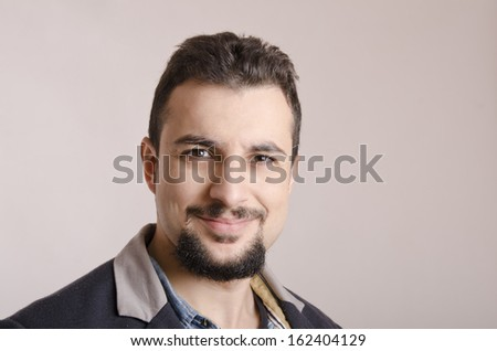 Studio portrait of bearded and expressive attractive man - stock photo