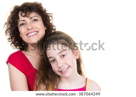 Studio portrait of beautiful little girl and her mother - isolated on white