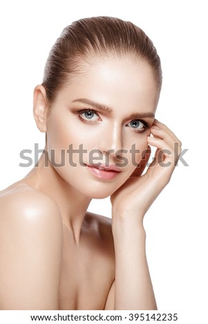 studio portrait of beautiful model with professional makeup on white background. Perfect fresh skin. Blue eyes. Brunette hair. Isolated - stock photo