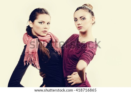 Studio portrait of beautiful sexy girls  in fashion style