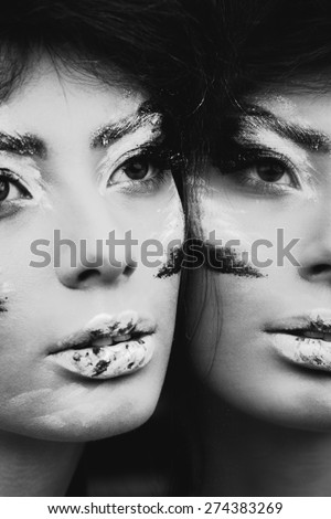 Studio portrait of beautiful woman with creative make-up. Black and white