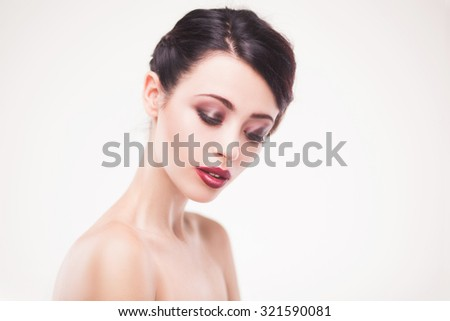 studio portrait of beautiful woman with fresh daily makeup and romantic wavy hairstyle - stock photo