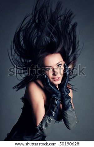 studio portrait of beautiful woman with hair up - stock photo