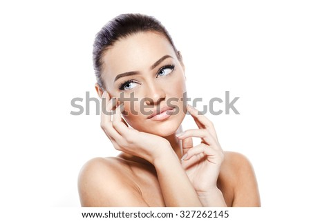 Studio portrait of  beautiful woman with perfect clean skin - stock photo