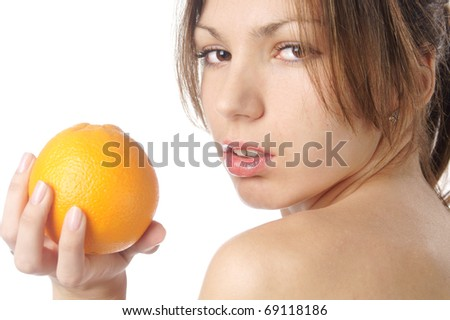 studio portrait of beautiful young woman with lemon against white background - stock photo