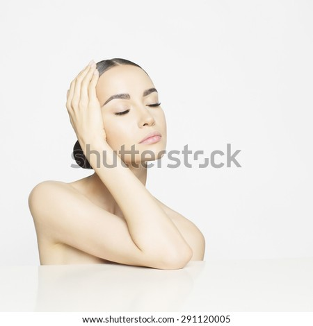 Studio portrait of beautiful young woman with perfect skin. Beauty and care. Spa salon - stock photo