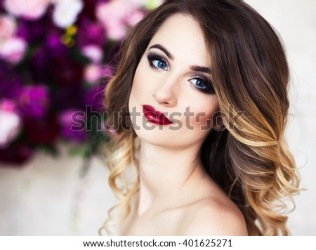 Studio portrait of blooming gorgeous blonde lady in fantastic creative dress of flowers. Perfect hair and skin. - stock photo