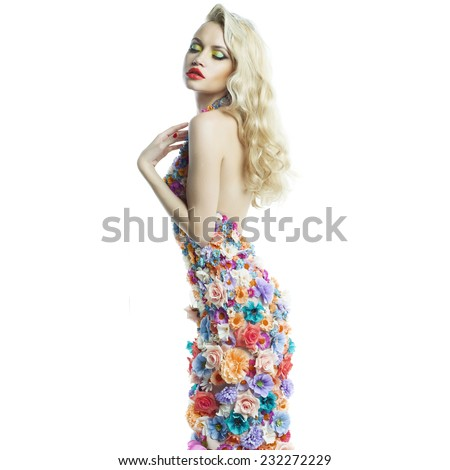 Studio portrait of blooming gorgeous lady in dress of flowers - stock photo