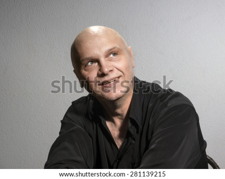 Studio portrait of caucasian bald men. Emotions. Dreamy - stock photo