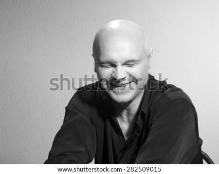 Studio portrait of caucasian bald men. Emotions. joyful - stock photo