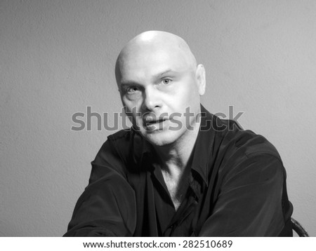 Studio portrait of caucasian bald men. Emotions. surprised - stock photo