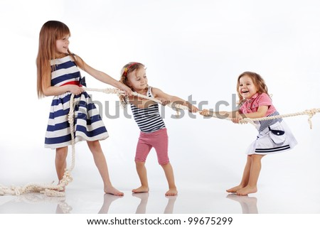 Studio portrait of children sea theme - stock photo