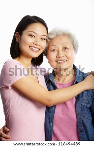 Studio Portrait Of Chinese Mother With Adult Daughter - stock photo