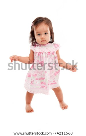 Studio portrait of Cute asian child stand up . - stock photo