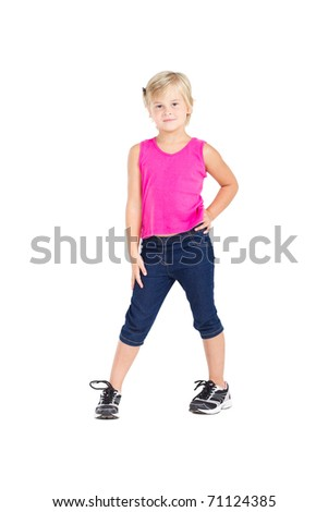 studio portrait of cute little girl standing on white