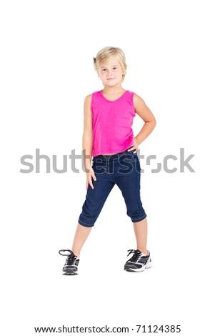 studio portrait of cute little girl standing on white - stock photo