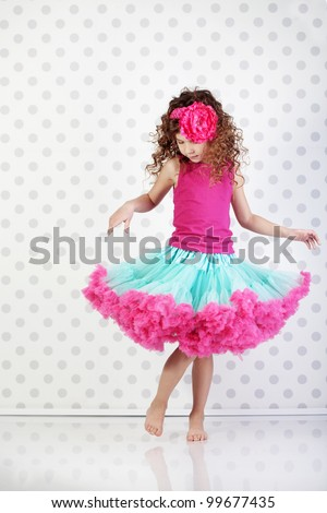 Studio portrait of cute little princess wearing beautiful tutu skirt - stock photo