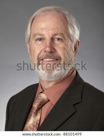 Studio portrait of distinguished looking mature Caucasian man. - stock photo