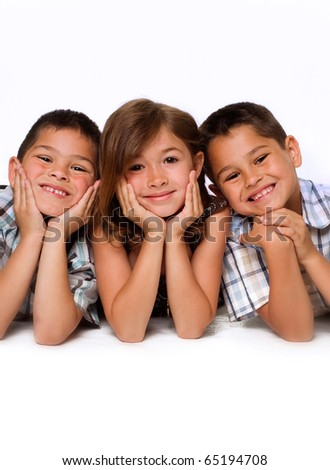 Studio portrait of family group of children with sister beside two brothers. - stock photo