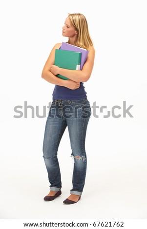Studio Portrait Of Female Student Holding Folders - stock photo
