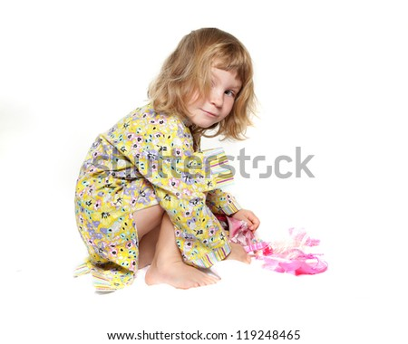 studio portrait of funny young girl playing with toys isolated over white
