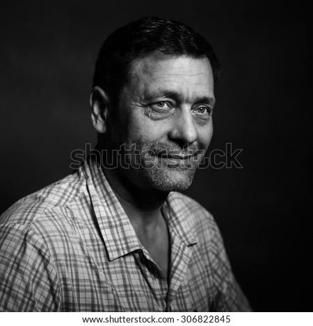 studio portrait of good man - stock photo