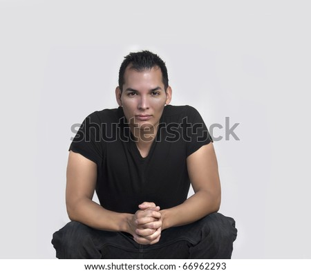 Studio portrait of handsome man - stock photo