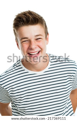 Studio portrait of Handsome teen laughing.Isolated on white background.