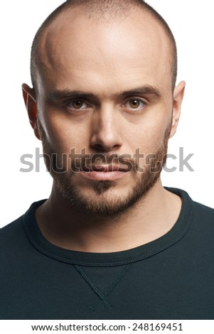 Studio portrait of handsome young man looking in camera