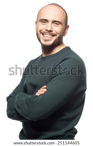 Studio portrait of happy young man with crossed arms, isolated on white background - stock photo