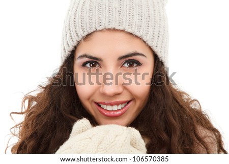 Studio portrait of happy young woman in winter clothing isolated on white background