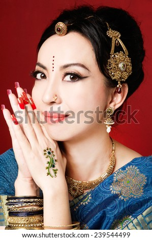 Studio portrait of Indian beauty - stock photo