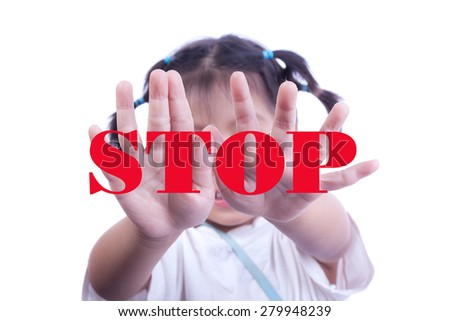 Studio portrait of little girl showing stop hand sign or signal in front of face,Stop concept - stock photo