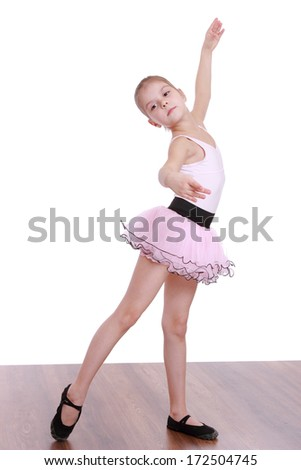 Studio portrait of lovely little girl dressed as a ballerina isolated on white background on Art theme/Happy young ballerina - stock photo