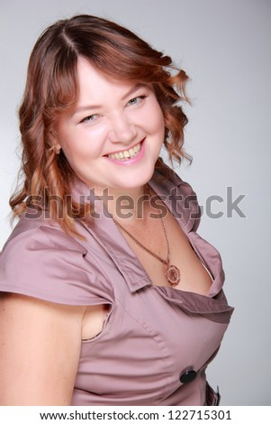 Studio portrait of lovely smiley mid adult beautiful woman on Beauty and Fashion theme - stock photo