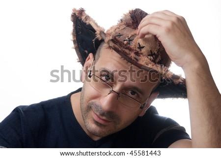 studio portrait of man in glasses wearing hat - stock photo