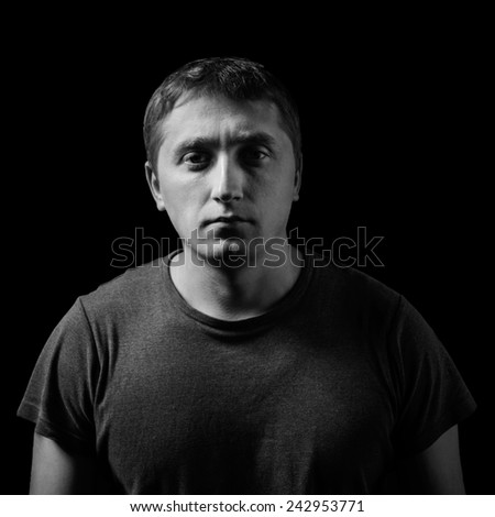 studio portrait of man. low key - stock photo