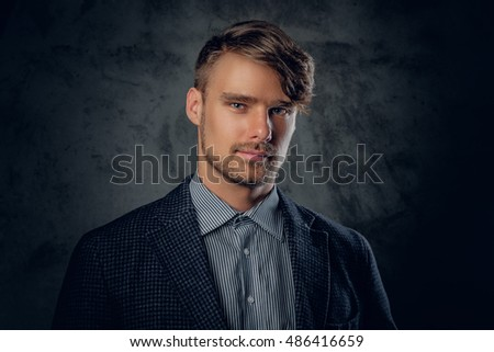Studio portrait of modern, stylish male on glance grey background.