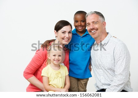 Studio Portrait Of Pre School Teachers With Pupils - stock photo
