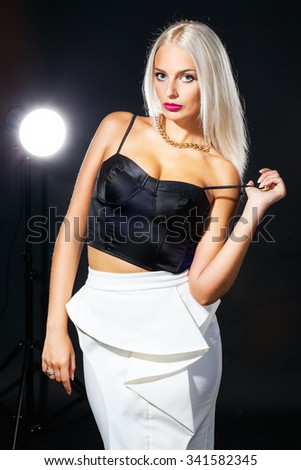 studio portrait of pretty fashionable girl - stock photo