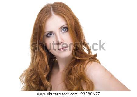 studio portrait of pretty redhead girl on a light background.