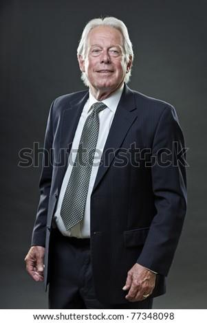 Studio portrait of senior business man smiling. - stock photo