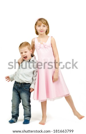 Studio portrait of siblings beautiful boy and girl on white background