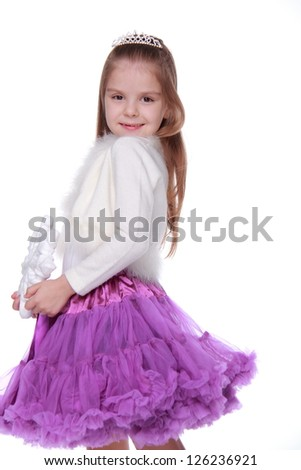 Studio portrait of smiley european little girl on Beauty and Fashion theme
